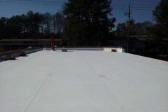 Our finished commercial roof replacement now leaves this property protected from the elements.